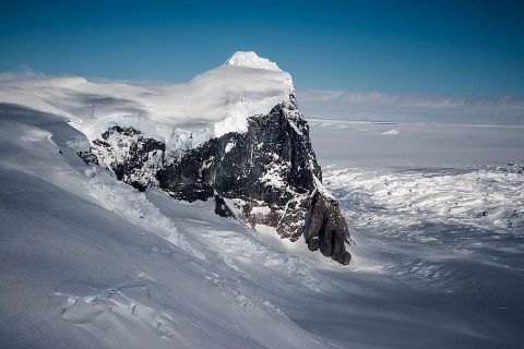 A rock outcropping on Fleming Glacier, which feeds one of the accelerating glaciers in Marguerite Bay on the western Antarctic Peninsula. (NASA/OIB)