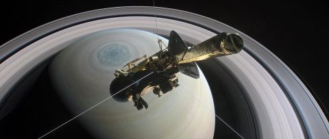NASA's Cassini spacecraft is shown heading for the gap between Saturn and its rings during one of 22 such dives of the mission's finale in this illustration. The spacecraft will make a final plunge into the planet's atmosphere on Sept. 15. (NASA/JPL-Caltech)