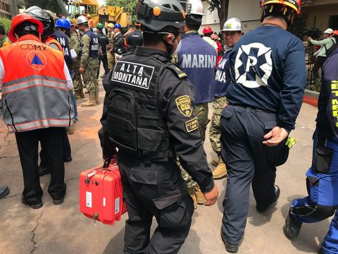 An emergency responder in Mexico City carries an orange case holding a radar instrument called FINDER. This technology can detect the heartbeats of earthquake survivors buried under rubble. It was developed in a collaboration between NASA's Jet Propulsion Laboratory and the Department of Homeland Security's Science and Technology Directorate, then licensed to private companies like SpecOps Group, Inc. (SpecOps Group, Inc)