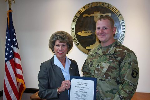 Clarksville Mayor Kim McMillan presents a Certificate of Appreciation to SFC Timothy Hansen for his life-saving efforts.