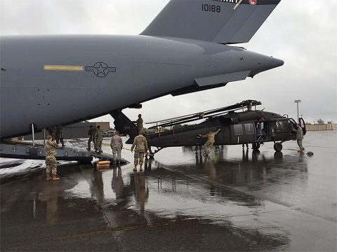 Tennessee Army National Guard Soldiers of the 1-230th Aviation Regiment load a UH-60L Blackhawk helicopter on to a New York Air National Guard C-17 Globemaster III to assist in recovery efforts in the US Virgin Islands following Hurricane Irma.