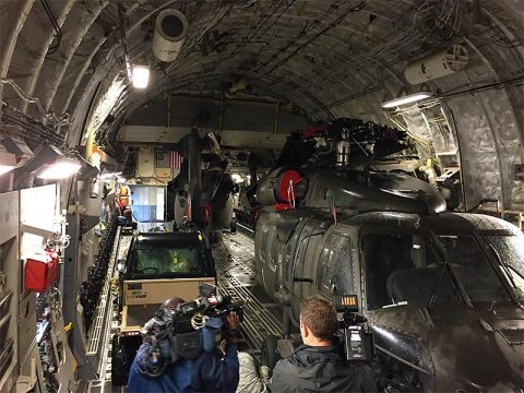 A Tennessee Army National Guard UH-60L Blackhawk helicopter becomes the cargo for a New York Air National Guard C-17 Globemaster III.  The helicopters are headed to the US Virgin Islands to assist in recovery operations following Hurricane Irma.