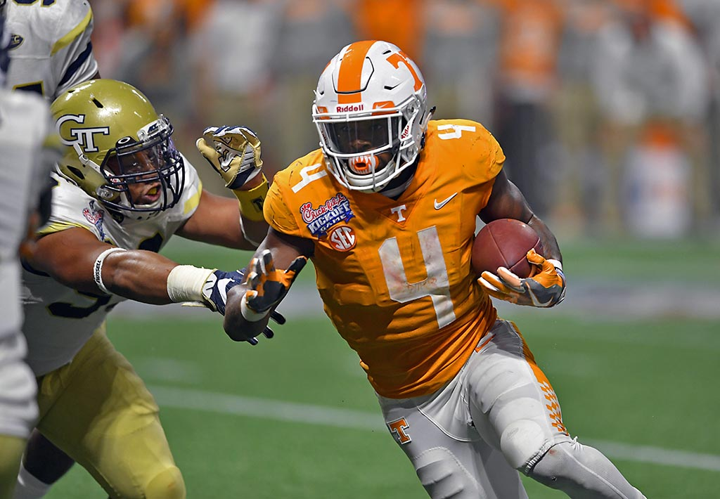 Tennessee Volunteers running back John Kelly (4) carries the ball for a touchdown against the Georgia Tech Yellow Jackets during the fourth quarter at Mercedes-Benz Stadium. (Dale Zanine-USA TODAY Sports)