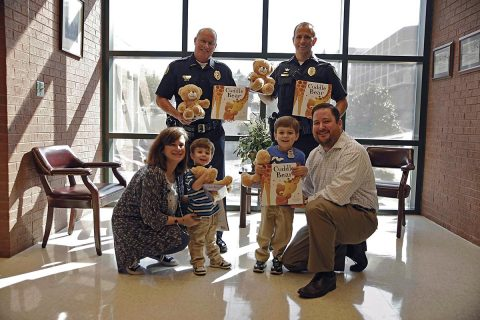 (L to R) Shari Brown, Silas Brown, Henry Brown, Wesley Brown. Standing (L to R), Deputy Chief Mike Parr, Lt Chad Koyama. (Jim Knoll, CPD)