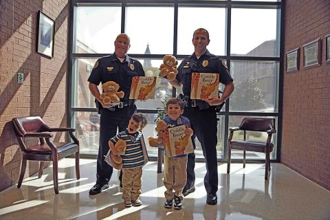 First row - Silas Brown, Henry Brown. 2nd Row - Deputy Chief Mike Parr, Lt Chad Koyama. (Jim Knoll, CPD)