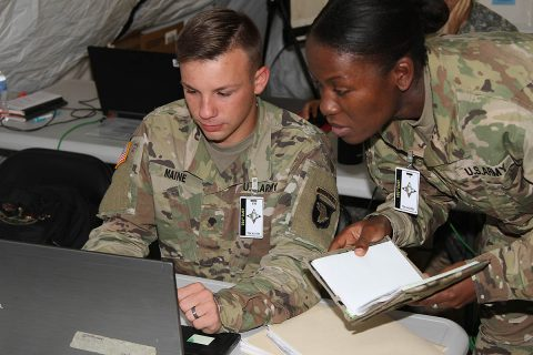 Private First Class Jordan Maine, a human resource specialist with the 101st Airborne Division Sustainment Brigade, 101st Abn. Div., works with Staff Sgt. Shenea Andrews, religious affairs noncommissioned officer in charge for the 101st Abn. Div. Sust. Bde., 101st Abn. Div., Sept. 27, during the brigade command post exercise on Fort Campbell. (101st Sustainment Brigade, 101st Airborne Division (AA) Public Affairs)