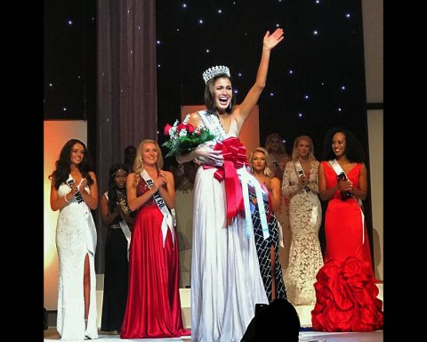 Newly crowned Miss Tennessee USA Alexandra Harper waves to the crowd at Austin Peay State University.