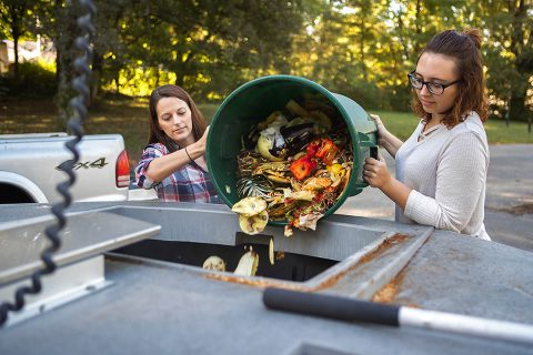 Director of the APSU Center for Service Learning & Community Engagement, Alexandra Wills and Student Worker, Leslie Warren demonstrate the waste compost on campus.