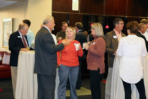 Brian Taylor, CDE Lightband General Manager, greets guests at a reception to celebrate CDE