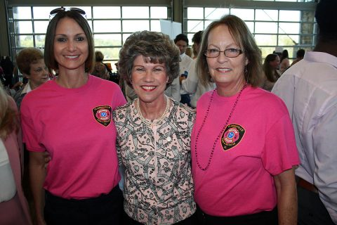Clarksville Mayor Kim McMillan congratulates Gina Mills (left) and Susan Harris for their work selling pink Clarksville Fire Rescue T-shirts, raising a $2,500 donation to the YMCA's ABC Program.