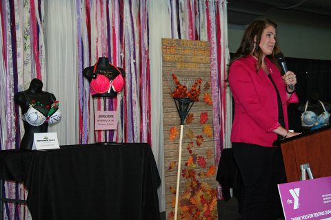 Angela Piekielko, local ABC Program coordinator, addresses the Tickle Me Pink crowd and shares the stage with several entries in the Battle of the Bras competition.