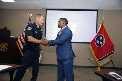 Clarksville Police Chief Al Ansley presents Willie Austin with a Citizen Commendation Friday.
