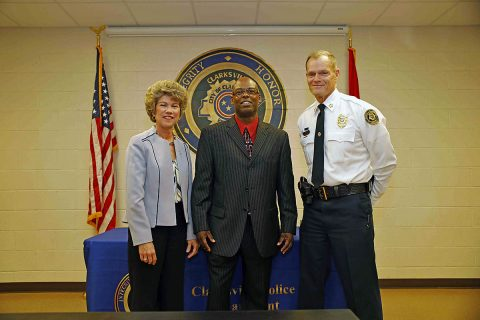Clarksville Mayor Kim McMillan and Clarksville Police Chief Al Ansley congratulate CPD Sgt. Timothy Saunders, who is retiring after 28 years with the department.