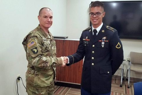 Sgt. Maj. Reeves Winters, chaplain sergeant major for the 101st Airborne Division (Air Assault), congratulates Pfc. Boaz Koski, chaplain assistant for the 101st Special Troops Battalion, 101st Airborne Division (Air Assault) Sustainment Brigade, 101st Abn. Div., after earning the title of the 101st Abn. Div. Chaplain Assistant of the Year, Sept. 20, 2017, on Fort Campbell, Kentucky. (Courtesy Photo)