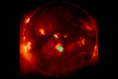 The NASA-funded FOXSI instrument captured new evidence of small solar flares, called nanoflares, during its December 2014 flight on a suborbital sounding rocket. Nanoflares could help explain why the Sun's atmosphere, the corona, is so much hotter than the surface. Here, FOXSI's observations of hard X-rays are shown in blue, superimposed over a soft X-ray image of the Sun from JAXA and NASA's Hinode solar-observing satellite. (JAXA/NASA/Hinode/FOXSI)