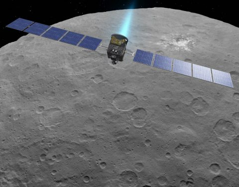 This artist concept shows NASA's Dawn spacecraft above dwarf planet Ceres, as seen in images from the mission. (NASA/JPL-Caltech)
