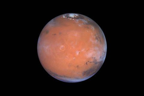 A new paper suggests hydrogen-possibly water ice-in the Medusa Fossae area of Mars, which is in an equatorial region of the planet to the lower left in this view. (Steve Lee (University of Colorado), Jim Bell (Cornell University), Mike Wolff (Space Science Institute), and NASA)