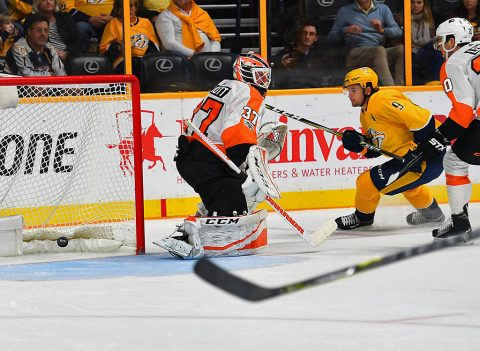 Nashville Predators left wing Filip Forsberg (9) scores past Philadelphia Flyers goalie Brian Elliott (37) during the third period at Bridgestone Arena. (Christopher Hanewinckel-USA TODAY Sports)