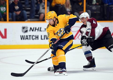 Nashville Predators left wing Viktor Arvidsson (33) works around Colorado Avalanche defenseman Tyson Barrie (4) for a short handed shot during the first period at Bridgestone Arena. (Christopher Hanewinckel-USA TODAY Sports)