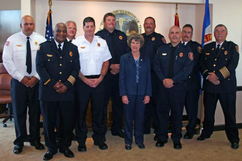 Deputy Fire Chief Ray Williams, second from left, Clarksville Mayor Kim McMillan and Clarksville Fire Chief Mike Roberts, right, joined to congratulate the seven Clarksville Fire Rescue leaders who recently earned promotions.