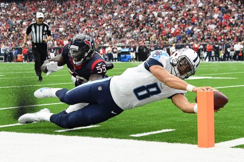 Tennessee Titans quarterback Marcus Mariota (8) scores a touchdown ahead of Houston Texans outside linebacker Whitney Mercilus (59) during the second quarter at NRG Stadium Oct. 1, 2017. (Shanna Lockwood-USA TODAY Sports)