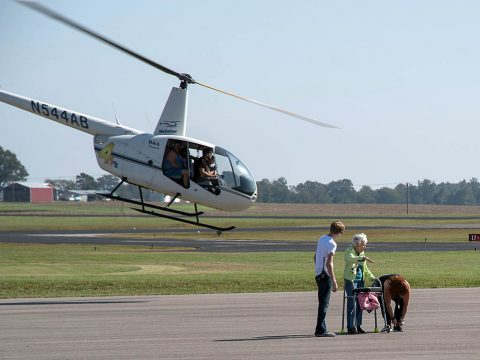 Attendees at the Wags & Wings Family Fun Fest enjoy helicopter rides, October 14th. Airplane and helicopter rides were part of the inaugural event at Clarksville Regional Airport, which raised awareness for the Humane Society of Clarksville-Montgomery County and its mission. (Josh Vaughn)