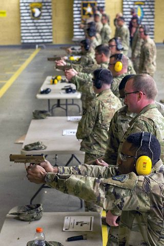 Soldiers with C Company, 1st Battalion, 506th Infantry Regiment, 1st Brigade Combat Team, 101st Airborne Division (Air Assault) fire the new M17 or Modular Handgun System at the 5th Special Forces Group (Airborne) indoor range, November 28th. (Sgt. Samantha Stoffregen, 101st Airborne Division (Air Assault) Public Affairs)