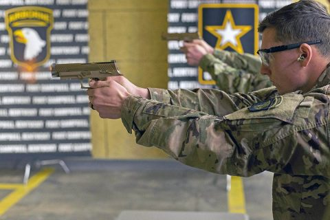 A Soldier with C Company, 1st Battalion, 506th Infantry Regiment, 1st Brigade Combat Team, 101st Airborne Division (Air Assault) fires the new M17 or Modular Handgun System at the 5th Special Forces Group (Airborne) indoor range, November 28th. The 101st ABN DIV (AASLT), the word's only air assault division, is the first unit in the Army to field the service's new handgun. (Sgt. Samantha Stoffregen, 101st Airborne Division (Air Assault) Public Affairs)