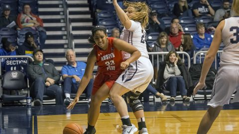 Austin Peay Women's Basketball junior guard Keisha Gregory drives to the basketball Saturday night against Butler. (APSU Sports Information)