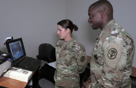 Blanchfield Army Community Hospital Chief of Soldier Health Services Maj. Tammy Smoak shows Regional Health Command Atlantic Commander Brig. Gen. R. Scott Dingle how she conducts a Virtual Health appointment. Smoak uses a computer and video camera at one of her health clinics to connect over a secure network to Health Technician Kelly Money at Fort Campbell's Soldier Support Center. Smoak uses this virtual connection to conduct medical visits with Soldiers completing their Periodic Health Assessment, an annual requirement for all service members. Blanchfield is able to save time and improve readiness by conducting these assessments virtually during Soldier in-processing. (Maria Yager)