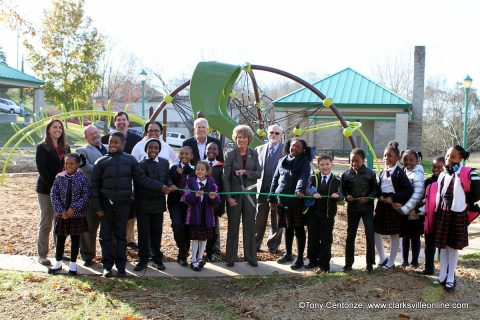 Clarksville Mayor Kim McMillan, Clarksville Parks and Recreation Director Jennifer Letourneau, members of the Clarksville City Council and students from Tabernacle Christian School cut a ribbon Monday formally reopening Valleybrook Park.
