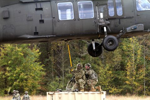 (L to R) Spc. Anthony Addcock and Staff Sgt. Jerry Barnhart from 594th Transportation Company, 129th Combat Sustainment Support Battalion, 101st Airborne Division (Air Assault) Sustainment Brigade, 101st Abn. Div., conduct a sling load operation during 129th CSSB's field training exercise on Fort Campbell, Kentucky, Oct. 25, 2017. (Pfc. Alexes Anderson/101st Airborne Division Sustainment Brigade)