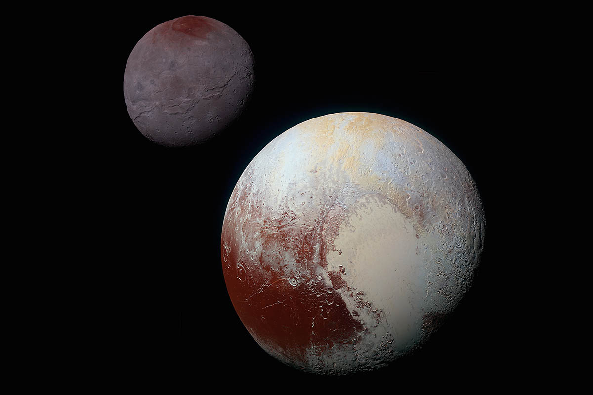 Composite, enhanced-color image of Pluto (lower right) and its largest moon Charon (upper left) taken by NASA's New Horizons spacecraft on July 14, 2015. Pluto and Charon are shown with approximately correct relative sizes, but their true separation is not to scale. (NASA/JHUAPL/SwRI)