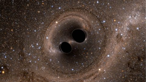 This computer simulation shows the collision of two black holes, which produces gravitational waves. (SXS)