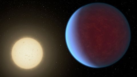 The super-Earth exoplanet 55 Cancri e, depicted with its star in this artist's concept, likely has an atmosphere thicker than Earth's but with ingredients that could be similar to those of Earth's atmosphere. (NASA)