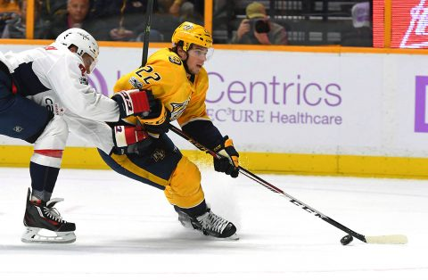 Nashville Predators left wing Kevin Fiala (22) skates past Washington Capitals defenseman Matt Niskanen (2) during the first period at Bridgestone Arena. (Christopher Hanewinckel-USA TODAY Sports)