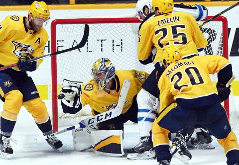 Nashville Predators goalie Pekka Rinne (35) makes a save during the third period against the Winnipeg Jets at Bridgestone Arena. (Christopher Hanewinckel-USA TODAY Sports)