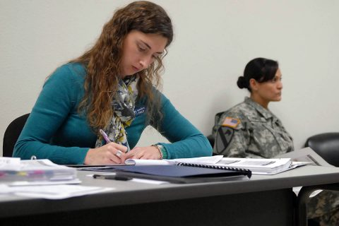 Katie Copeskey, left, a master resilience trainer-performance expert at the Fort Hood Comprehensive Soldier and Family Fitness Training Facility, takes notes during a Resilience Trainer Assistant Course in Killeen, Texas. (Sgt. John Couffer)