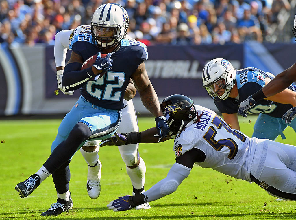Tennessee Titans running back Derrick Henry (22) runs for a short gain during the first half against the Baltimore Ravens at Nissan Stadium. (Christopher Hanewinckel-USA TODAY Sports)