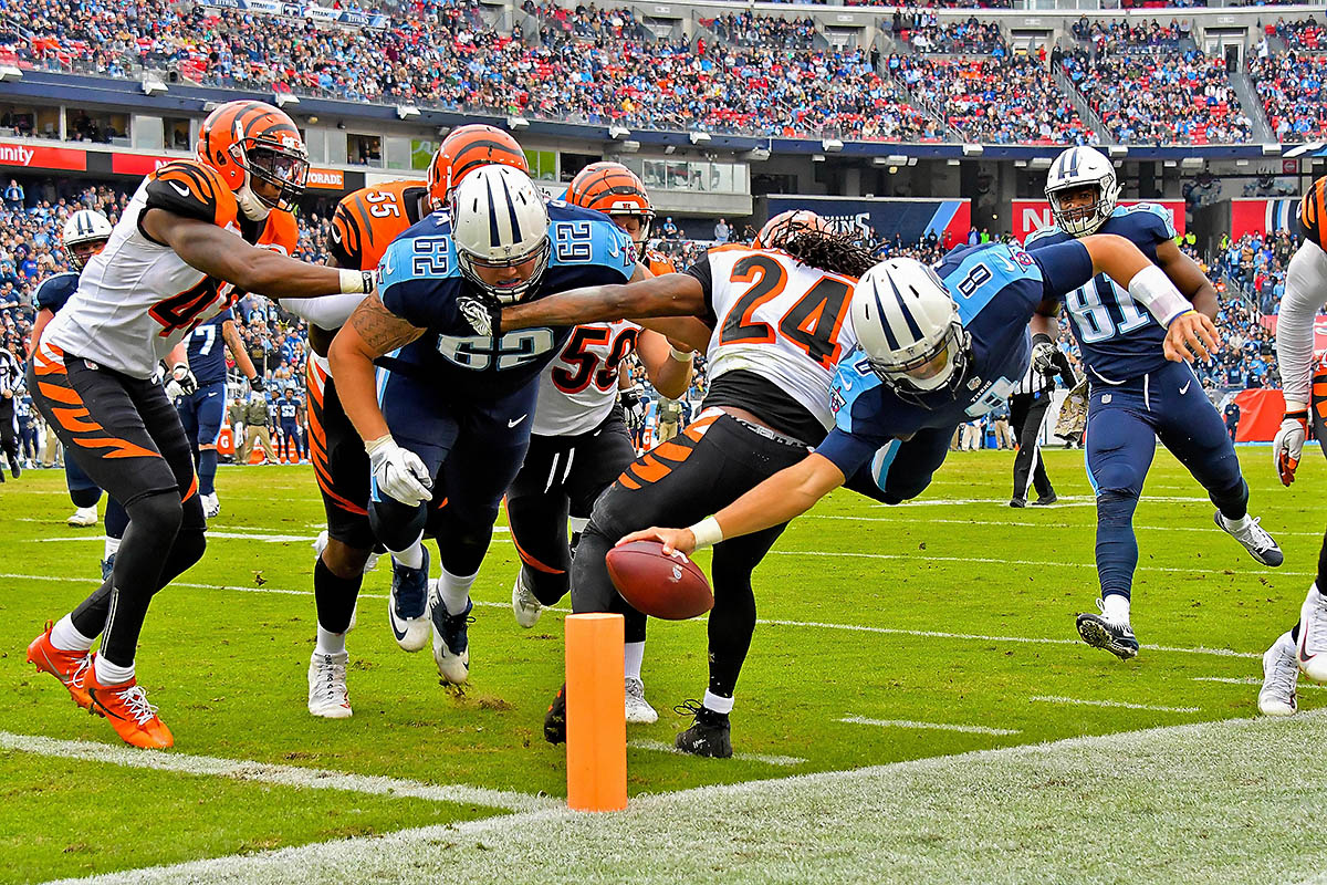 Tennessee Titans quarterback Marcus Mariota (8) is knocked out of bounds by Cincinnati Bengals cornerback Adam Jones (24) as he dives for the goal line during the first half at Nissan Stadium. (Jim Brown-USA TODAY Sports)