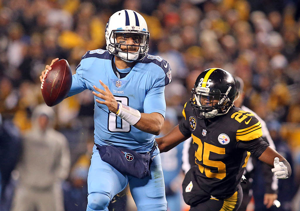 Tennessee Titans quarterback Marcus Mariota (8) scrambles with the ball as Pittsburgh Steelers cornerback Artie Burns (25) pressures during the first quarter at Heinz Field. (Charles LeClaire-USA TODAY Sports)