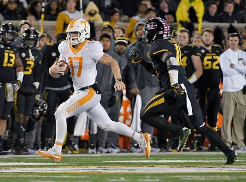 Tennessee Volunteers quarterback Will McBride (17) runs the ball as Missouri Tigers safety Jordan Ulmer (11) chases during the first half at Faurot Field. (Denny Medley-USA TODAY Sports)