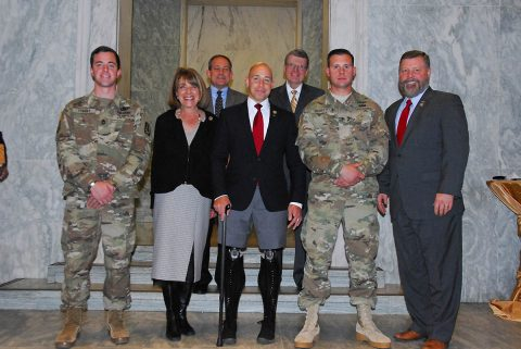 EOD Team of the Year members Sgt. First Class Joshua Tygert (left) and Sgt. Austin Murphy (center) are congratulated by Reps. Susan Davis, Brian Mast and Rick Crawford at the EOD Day on the Hill November 7th. Sponsors from the National Defense Industrial Association (back) added their congratulations. (U.S. Army photo by MAJ. Troy Frey)