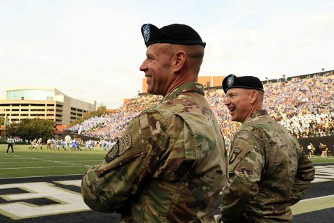 Lt. Col. Hugh Sollom, and Command Sgt. Maj. Jonathan Simmons, commander and command sergeant major, respectively, of the 2nd Battalion, 32nd Field Artillery Regiment, 101st Airborne Division Artillery, take in the University of Kentucky vs. Vanderbilt University football game, at VU, Nov. 11. Vanderbilt opened their stadium for active duty soldiers and their family members in recognition of Veterans Day. (Staff Sgt. Todd Pouliot, 40th Public Affairs Detachment)
