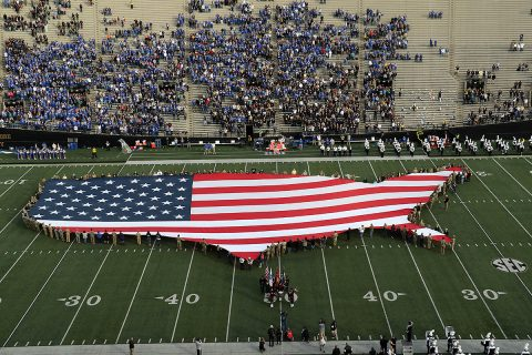 Soldiers of the 2nd Battalion, 32nd Field Artillery Regiment, 101st Airborne Division Artillery, hold the ceremonial replica flag before the University of Kentucky vs. Vanderbilt University football game, Nov. 11. The replica flag was in the shape of the continental United States of America, and was part of Vanderbilt University's Veterans Day Salute to Service. (Staff Sgt. Todd Pouliot, 40th Public Affairs Detachment)