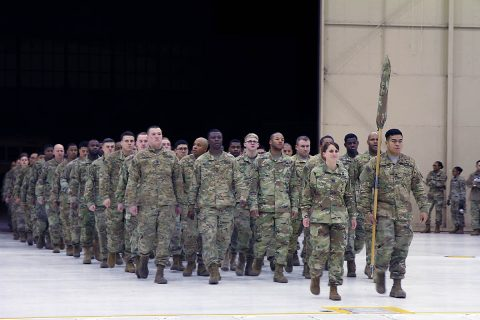 Capt. Amanda Fonk, commander of 227th Composite Supply Company, 129th Combat Sustainment Supply Company, 101st Airborne Division Sustainment Brigade, 101st Abn. Div., marches through the doors at Hanger 3 on Fort Campbell, Kentucky with her Soldiers, November 29th, 2017, during the company's welcome home ceremony. (Sgt. Caitlyn Byrne/101st SBDE Public Affairs)