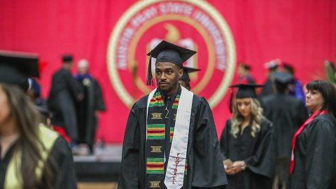 19 Austin Peay Athletes cross stage at 2017 APSU Winter Commencement ceremony. (APSU Sports Information)