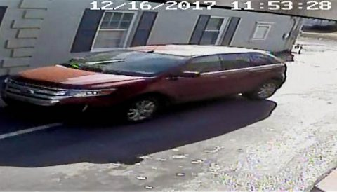 Last Friday, a woman was robbed in a parking lot on Madison Street. The suspect drove away in the red ford pictured.