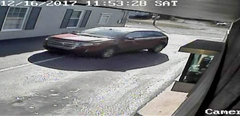 A woman was robbed in a parking lot on Madison Street. The suspect drove away in the red ford pictured.