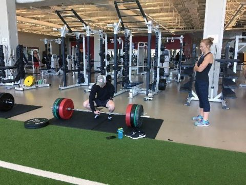 SPC Mike Painter receives one on one gym time from Physical Therapist Lindsey Davison. (Fort Campbell WTB Adaptive Reconditioning)